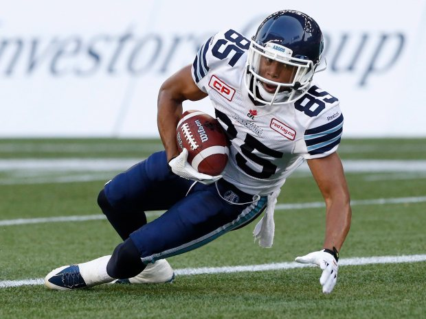 Toronto Argonauts' Diontae Spencer (85) hauls in the touchdown pass against the Winnipeg Blue Bombers during the first half of CFL action in Winnipeg Friday, August 14, 2015. THE CANADIAN PRESS/John Woods