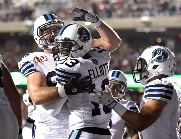 Toronto Argonauts' Kevin Elliott (13) celebrates with teammates after scoring a touchdown against the Ottawa Redblacks during first half CFL action in Ottawa on Saturday, Sept. 26, 2015. THE CANADIAN PRESS/Justin Tang