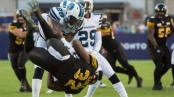 Hamilton Tiger-Cats running back C.J. Gable (32) is body slammed by Toronto Argonauts linebacker Brandon Isaac (28) during second half CFL football action in Toronto on Sunday, September 11, 2016. THE CANADIAN PRESS/Nathan Denette